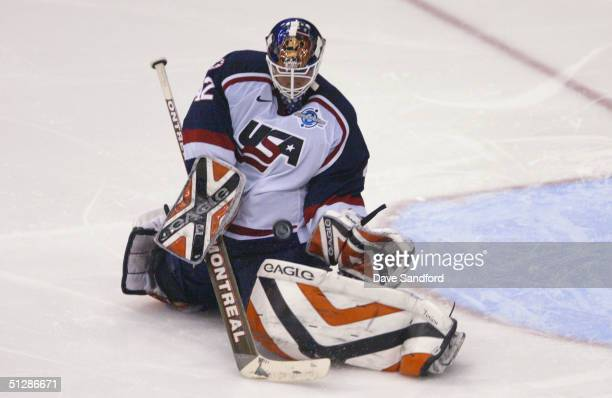 Goaltender Robert Esche of Team USA makes a save against Team Finland during the third period of the 2004 World Cup of Hockey semifinal game on...