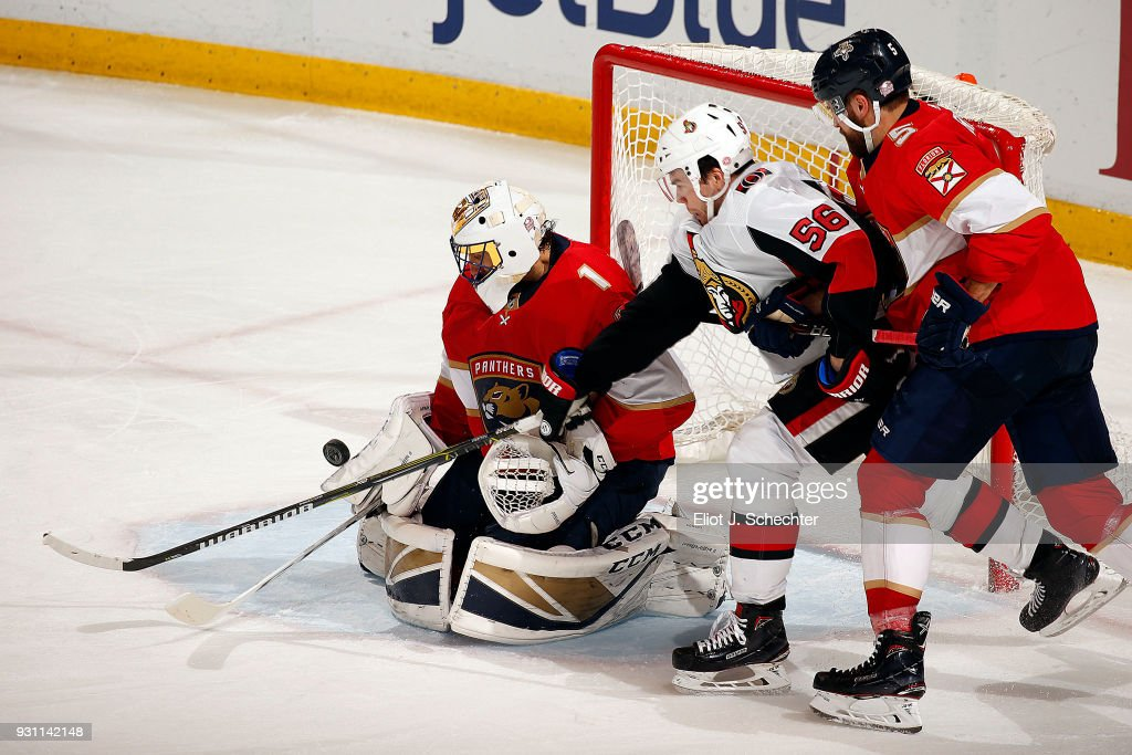 Goaltender Roberto Luongo #1 and Aaron Ekblad #5 of the Florida Panthers defend the net against Magnus Paajarvi #56 of the Ottawa Senators at the BB&T Center on March 12, 2018 in Sunrise, Florida.