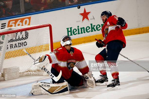 Goaltender Roberto Luongo and Keith Yandle of the Florida Panthers keep theirs eyes on a loose puck in overtime against the Dallas Stars at the BBT...