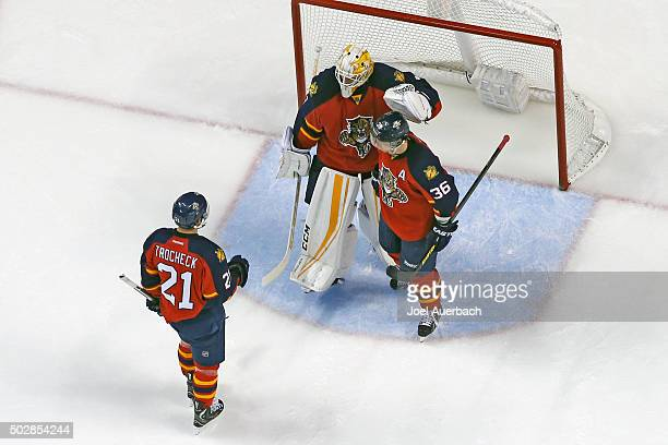 Goaltender Roberto Luongo celebrates the victory with Vincent Trocheck and Jussi Jokinen of the Florida Panthers against the Montreal Canadiens at...