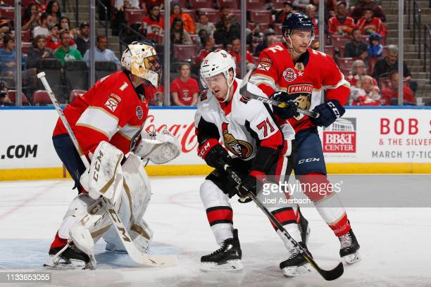 Goaltender Roberto Luongo defends the net as Josh Brown of the Florida Panthers checks Chris Tierney of the Ottawa Senators with his stick at the BBT...