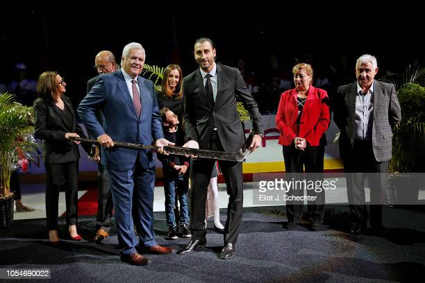 Goaltender Roberto Luongo is presented with a gold and crystal stick by President of Hockey Operations and General Manager Dale Tallon during a...