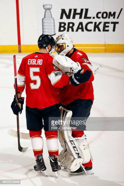 Goaltender Roberto Luongo of the Florida Panthers and teammate Aaron Ekblad celebrate their 21 over the Nashville Predators at the BBT Center on...