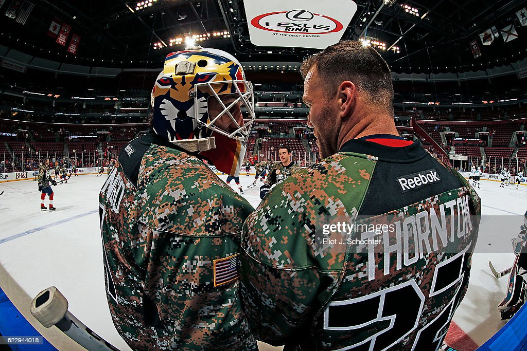 Goaltender Roberto Luongo Of The Florida Panthers And Teammate Shawn