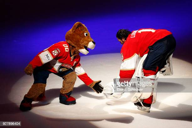 Goaltender Roberto Luongo of the Florida Panthers celebrates their 41 win with team Mascot Stanley C Panther over the Philadelphia Flyers at the BBT...