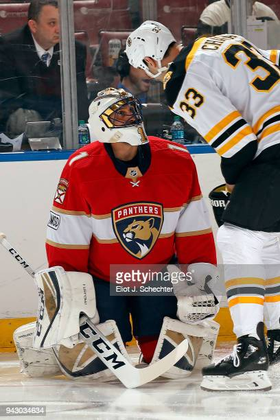 Goaltender Roberto Luongo of the Florida Panthers chats with Zdeno Chara of the Boston Bruins before playing in his 1000th NHL game at the BBT Center...