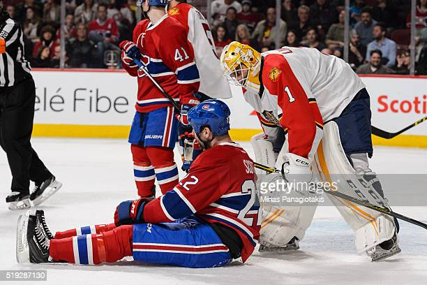 Goaltender Roberto Luongo of the Florida Panthers checks up on John Scott of the Montreal Canadiens during the NHL game at the Bell Centre on April 5...
