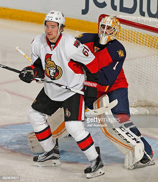 Goaltender Roberto Luongo of the Florida Panthers clears Mark Stone of the Ottawa Senators out of the crease during third period action at the BBT...