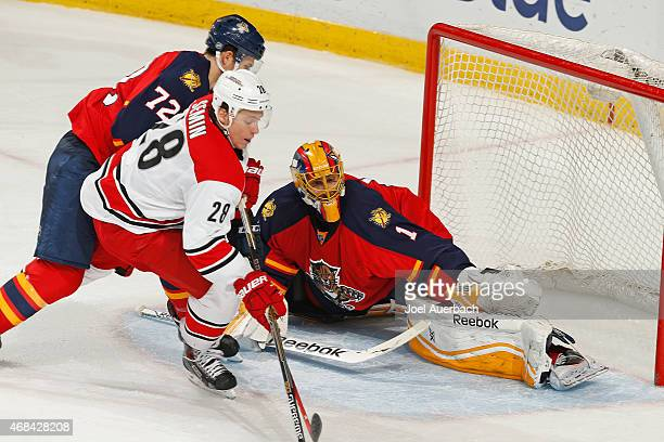 Goaltender Roberto Luongo of the Florida Panthers defends the net against the shot by Alexander Semin of the Carolina Hurricanes during third period...