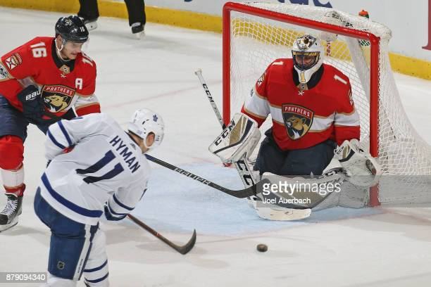 Goaltender Roberto Luongo of the Florida Panthers defends the net against the shot by Zach Hyman of the Toronto Maple Leafs during third period...