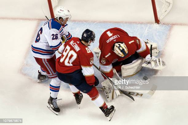 Goaltender Roberto Luongo of the Florida Panthers defends the net wit the help of teammate Jared McCann against Jimmy Vesey of the New York Rangers...