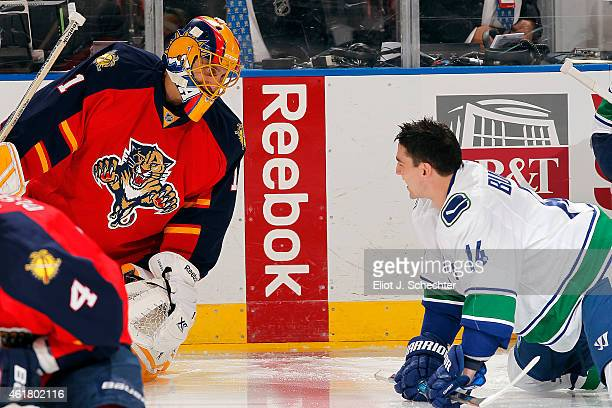 Goaltender Roberto Luongo of the Florida Panthers has a friendly chat with Alexandre Burrows of the Vancouver Canucks prior to the start of the game...