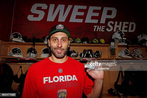 Goaltender Roberto Luongo of the Florida Panthers holds a puck commemorating his 1000th NHL game against the Boston Bruins at the BBT Center on April...