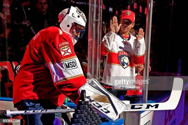 Goaltender Roberto Luongo of the Florida Panthers is greeted by fans while heading out to the ice for warm ups against the New York Rangers at the...