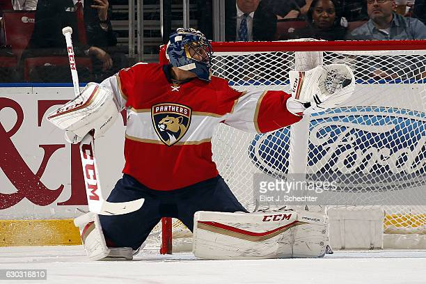 Goaltender Roberto Luongo of the Florida Panthers makes a glove save against the Buffalo Sabres at the BBT Center on December 20 2016 in Sunrise...