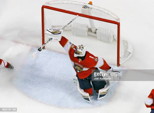 Goaltender Roberto Luongo of the Florida Panthers makes a stick save on a hot by the Edmonton Oilers during third period action at the BBT Center on...
