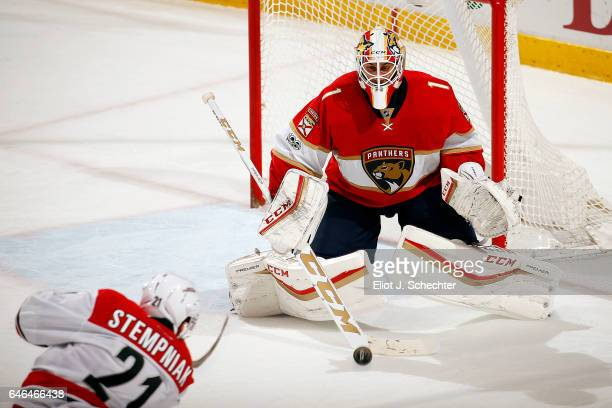 Goaltender Roberto Luongo of the Florida Panthers makes a stop against Lee Stempniak of the Carolina Hurricanes at the BBT Center on February 28 2017...
