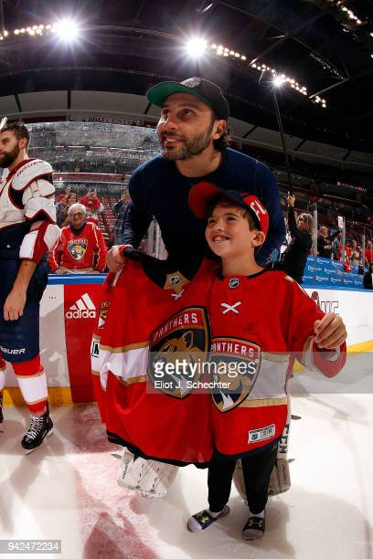 Goaltender Roberto Luongo of the Florida Panthers poses with a happy fan who received his game jersey After their 32 win over the Boston Bruins at...