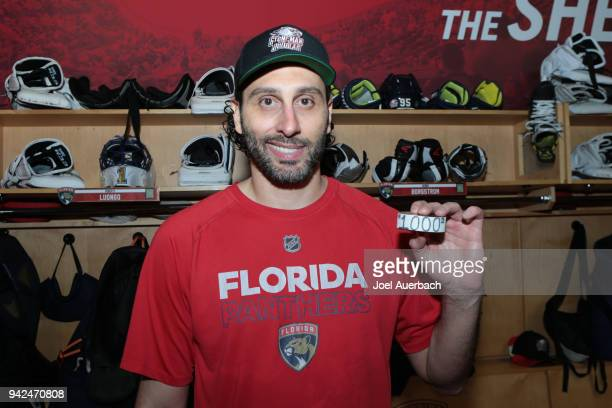 Goaltender Roberto Luongo of the Florida Panthers poses with a puck with the number 1000 on it after the game against the Boston Bruins at the BBT...