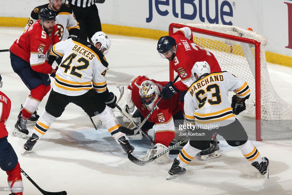 Goaltender Roberto Luongo #1 of the Florida Panthers stops a shot with Brad Marchand #63 and David Backes #42 of the Boston Bruins attempting to get the rebound at the BB&T Center on April 5, 2018 in Sunrise, Florida. The Panthers defeated the Bruins 3-2.