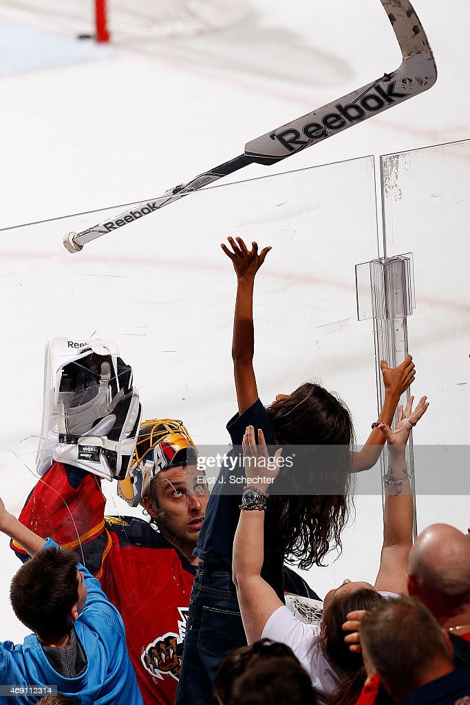 Goaltender Roberto Luongo #1 of the Florida Panthers tosses a stick over the glass to a fan after their win against the Boston Bruins at the BB&T Center on April 9, 2015 in Sunrise, Florida.