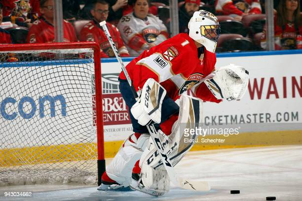 Goaltender Roberto Luongo of the Florida Panthers warms up on the ice before playing in his 1000th NHL game against the Boston Bruins at the BBT...
