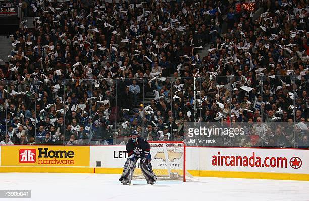 Goaltender Roberto Luongo of the Vancouver Canucks gets set for play against the Dallas Stars as the fans wave towels in game one of the Western...