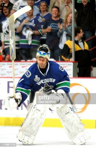 Goaltender Roberto Luongo of the Vancouver Canucks hits the ice with his stick as he is named first star after his 10 shut out the Boston Bruins in...