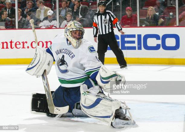 Goaltender Roberto Luongo of the Vancouver Canucks makes a glove save against the New Jersey Devils during their game at the Prudential Center on...