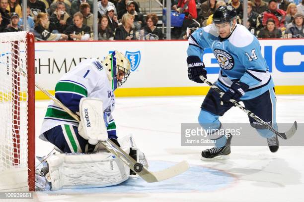 Goaltender Roberto Luongo of the Vancouver Canucks makes a save on the power play as Chris Kunitz of the Pittsburgh Penguins moves in looking for the...