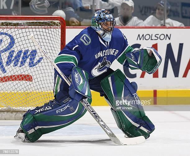Goaltender Roberto Luongo of the Vancouver Canucks readies himself for a shot during the game against the Pittsburgh Penguins at General Motors Place...