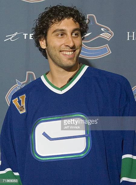 Goaltender Roberto Luongo wears a Vancouver Canuck jersey as he faces the media for the first time since his trade to the Vancouver Canucks from the...