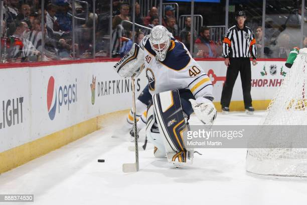 Goaltender Robin Lehner of the Buffalo Sabres clears the puck against the Colorado Avalanche at the Pepsi Center on December 5 2017 in Denver...