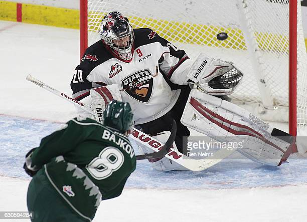 Goaltender Ryan Kubic of the Vancouver Giants makes a save against Patrick Bajkov of the Everett Silvertips during the second period of their WHL...