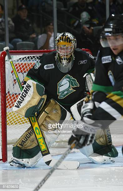Goaltender Ryan MacDonald of the London Knights eyes the play at the faceoff circle during a game against the Sault Ste. Marie Greyhounds at the John...