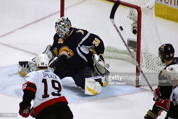 Goaltender Ryan Miller of the Buffalo Sabres could not stop the stop on a shot by Joe Corvo of the Ottawa Senators during the second overtime period...