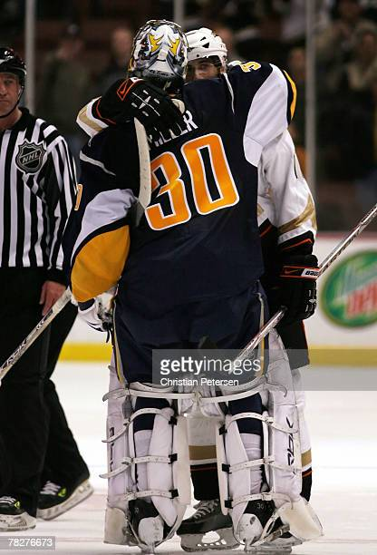 Goaltender Ryan Miller of the Buffalo Sabres hugs his brother Drew Miller of the Anaheim Ducks after the NHL game at Honda Center on December 5 2007...