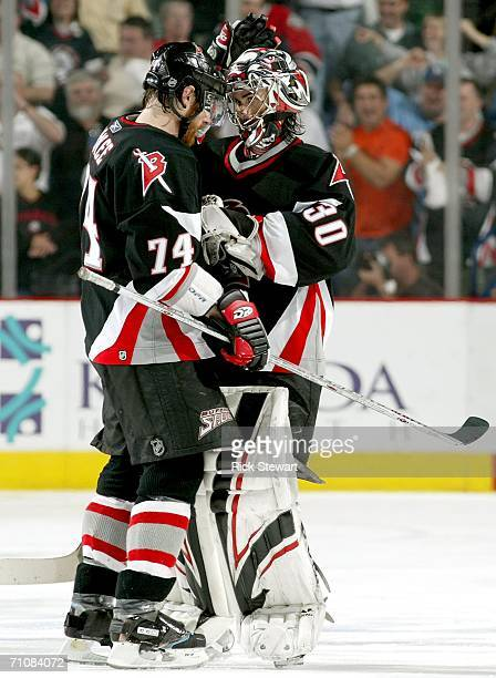 Goaltender Ryan Miller of the Buffalo Sabres is congratulated by teammate Jay McKee after their team won game six on a goal by Daniel Briere in...