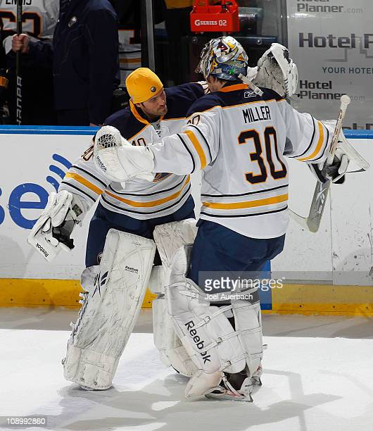 Goaltender Ryan Miller of the Buffalo Sabres is congratulated by teammate Patrick Lalime after an overtime win against the Florida Panthers on...