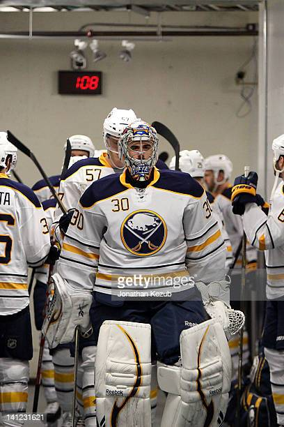 Goaltender Ryan Miller of the Buffalo Sabres leads his teammates to the ice for NHL action against the Winnipeg Jets at the MTS Centre on March 5...