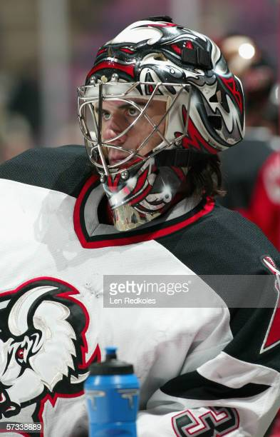 Goaltender Ryan Miller of the Buffalo Sabres looks on during the game against the New Jersey Devils at Continental Airlines Arena on March 30 2006 in...