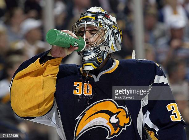 Goaltender Ryan Miller of the Buffalo Sabres takes a drink during the third period of Game 1 of the 2007 Eastern Conference Finals against the Ottawa...