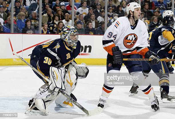 Goaltender Ryan Miller of the Buffalo Sabres tries to get a look at the play around the screen of Ryan Smyth of the New York Islanders during Game 2...