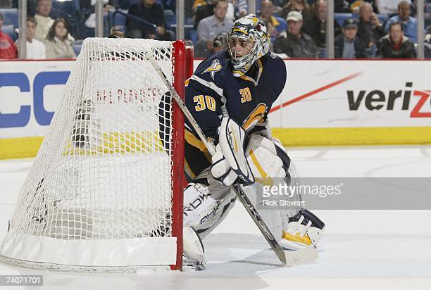 Goaltender Ryan Miller of the Buffalo Sabres watches the puck as he protects the side of the net against the New York Rangers in Game 1 of the...