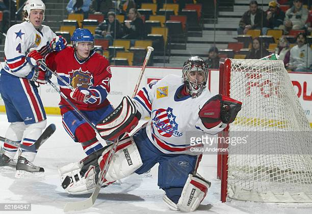 Goaltender Ryan Miller of the Rochester Americans makes a save against the Hamilton Bulldogs during the game at Copps Coliseum on January 26 2005 in...