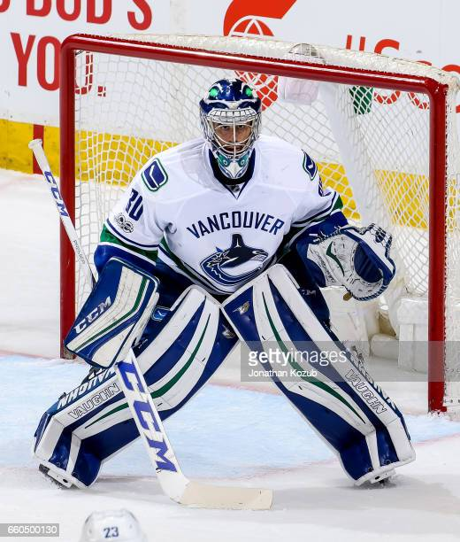 Goaltender Ryan Miller of the Vancouver Canucks guards the net during second period action against the Winnipeg Jets at the MTS Centre on March 26...