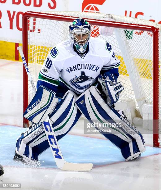Goaltender Ryan Miller of the Vancouver Canucks keeps an eye on the play during second period action against the Winnipeg Jets at the MTS Centre on...