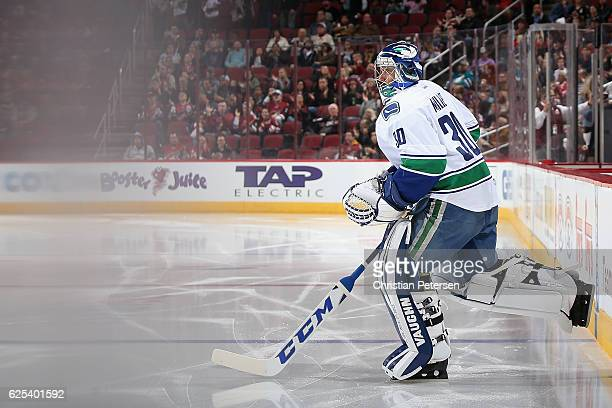 Goaltender Ryan Miller of the Vancouver Canucks skates out onto the ice before the start of the NHL game against the Arizona Coyotes at Gila River...