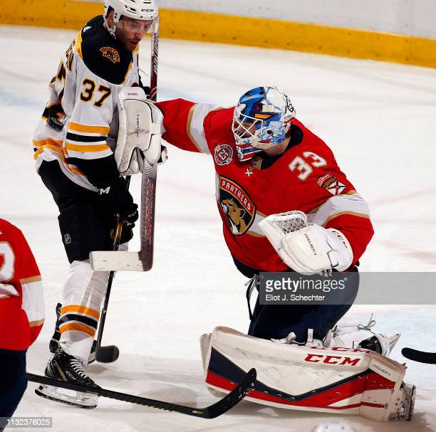 Goaltender Sam Montembeault of the Florida Panthers defends the net against Patrice Bergeron of the Boston Bruins at the BBT Center on March 23 2019...