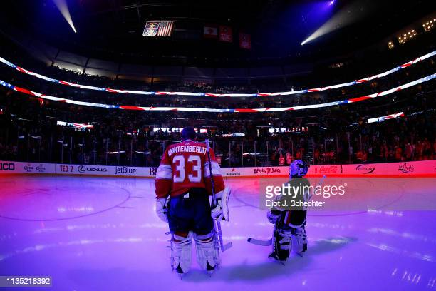 Goaltender Sam Montembeault of the Florida Panthers stands on the ice for the national anthem along with a guest skater prior to the start of the...